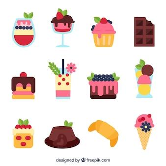 Słodka kolekcja deserów ze śmietaną i jagodami w stylu płaski