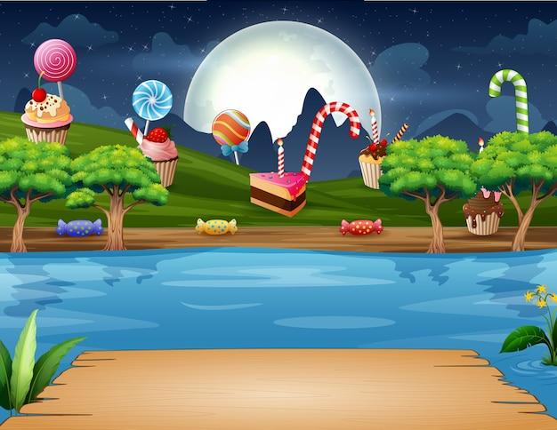 Słodka kraina nad brzegiem rzeki w nocy krajobraz