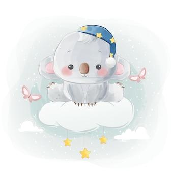 Słodka mała koala siedząca na chmurze