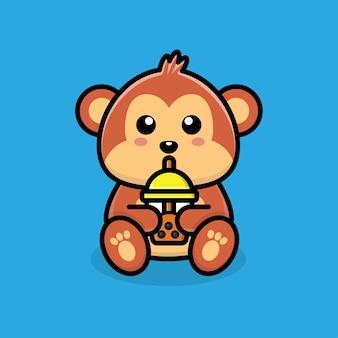 Słodka małpa pijąca herbatę boba