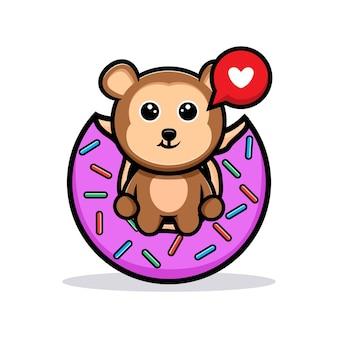 Słodka małpa siedzi i je różowy pączek kreskówka maskotka