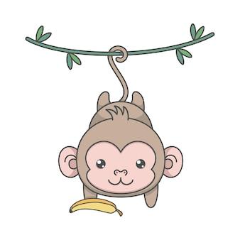 Słodka małpa wisi i trzyma banana