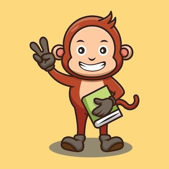 Słodka małpka trzymająca projekt książki