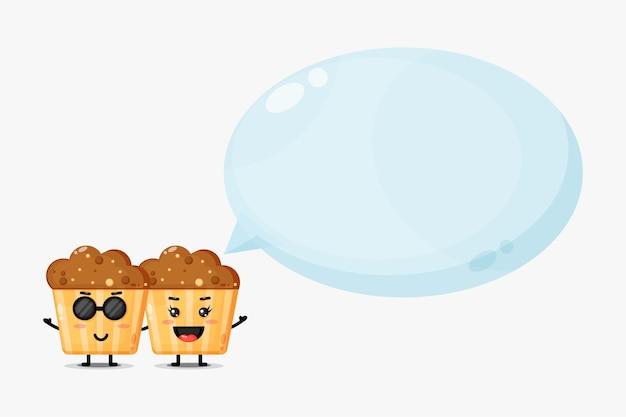 Słodka maskotka babeczki z mową bańki