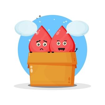 Słodka maskotka krwi w pudełku. ze smutnym i radosnym wyrazem twarzy
