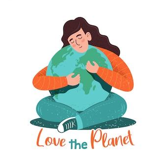 """Słodka postać młodej kobiety, która tuli planetę w stylu kreskówki hipster z teksturami i zwrotem """"love the planet""""."""