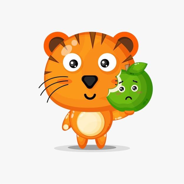 Słodka postać tygrysa niosąca zielone jabłko
