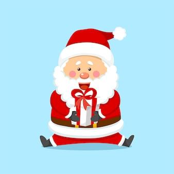 Słodki boże narodzenie święty mikołaj trzyma pudełko na prezent