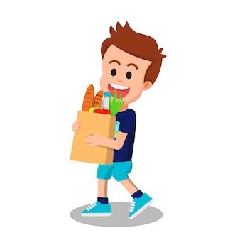 Słodki chłopak niosący torbę na zakupy