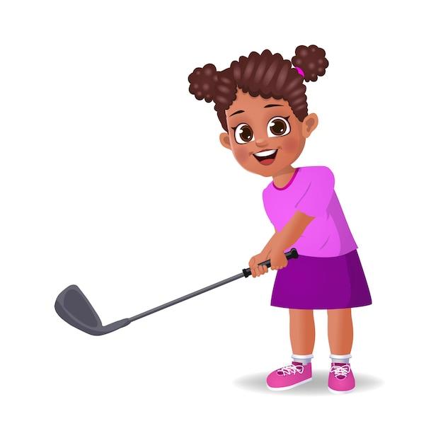 Słodki chłopiec grający w golfa