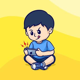 Słodki chłopiec siedzi grając w kreskówkową grę mobilną