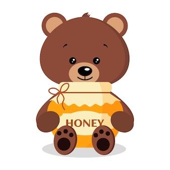 Słodki i słodki dziki niedźwiedź brunatny ze słoikiem pysznego świeżego miodu na białym tle.