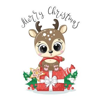 """Słodki jeleń z prezentem na boże narodzenie i frazą """"wesołych świąt""""."""