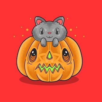 Słodki kot chowający się na dyni halloween