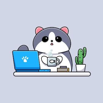 Słodki kot grający na laptopie