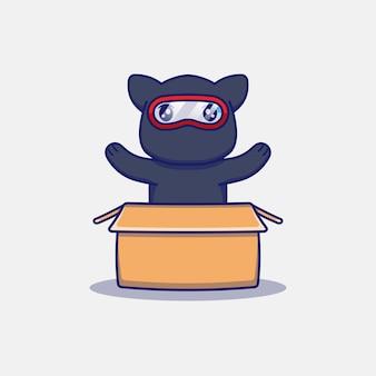Słodki kot ninja w kartonie