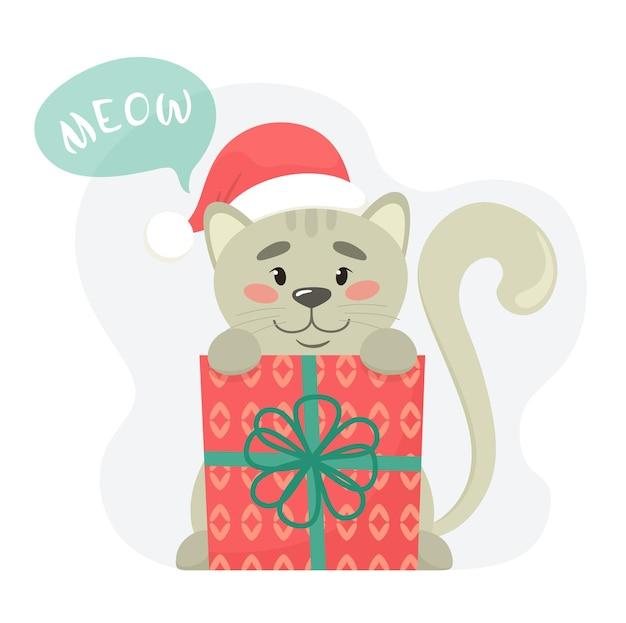 Słodki kotek z pudełkiem prezentowym i czapką mikołaja.