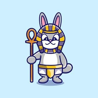 Słodki króliczek faraon niosący kij