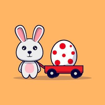 Słodki króliczek przynosi ozdobne jajka na koszyku na wielkanocny projekt ikony ilustracji