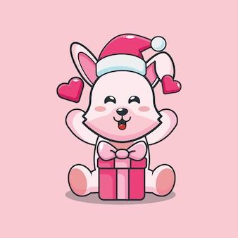 Słodki króliczek ubrany w santa hat z pudełkiem prezentowym w boże narodzenie śliczna świąteczna ilustracja kreskówka