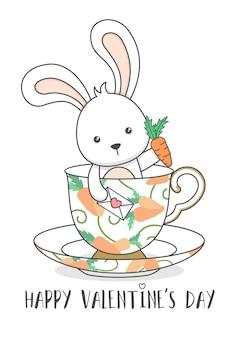 Słodki króliczek w filiżance trzymając marchew i list miłosny velentines dzień