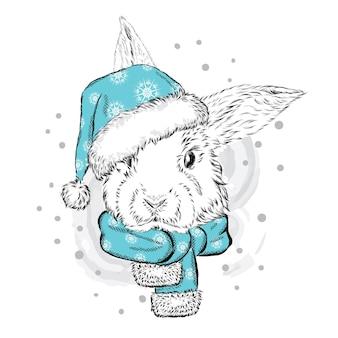 Słodki króliczek w świątecznych zimowych i noworocznych ubraniach