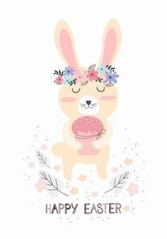 Słodki króliczek z ciastem wielkanocnym. kartkę z życzeniami lub banner w skandynawskim stylu wyciągnąć rękę. wesołych świąt wielkanocnych.