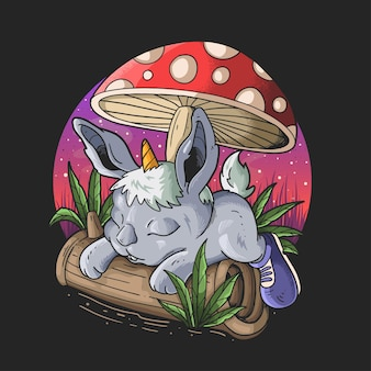Słodki króliczek z rogiem jednorożca leżący pod projektem ilustracji grzybowej kreskówki na czarnym tle