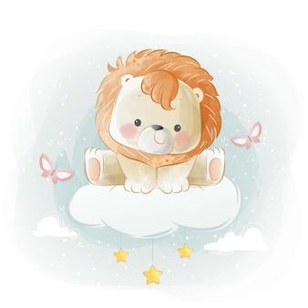 Słodki mały lew siedzący na chmurze