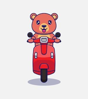 Słodki miś jadący na skuterze