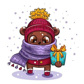 Słodki miś kreskówka w czapce i fioletowym szaliku niesie prezent na boże narodzenie.