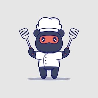 Słodki miś ninja w mundurze szefa kuchni i trzyma szpatułki