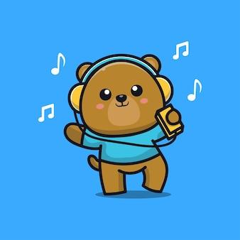 Słodki miś słucha muzyki w słuchawkach