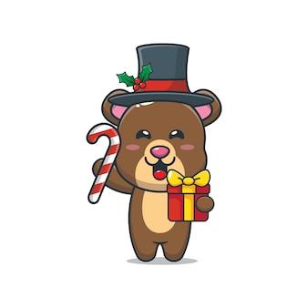 Słodki miś trzymający świąteczne cukierki i prezent śliczna świąteczna ilustracja kreskówka
