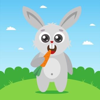 Słodki młody królik trzyma marchewkę w łapce i gryzie postać na tle natury