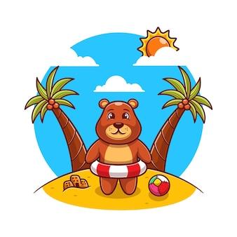 Słodki niedźwiedź brunatny stojący na plaży z płaskim pierścieniem pływackim.