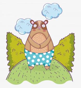 Słodki niedźwiedź dzikie zwierzę z krzakami i chmurami