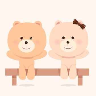 Słodki niedźwiedź para siedział na krześle