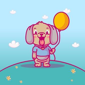 Słodki pies z balonem