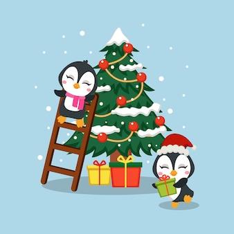 Słodki pingwin przygotowuje się na świąteczny prezent i dekorację