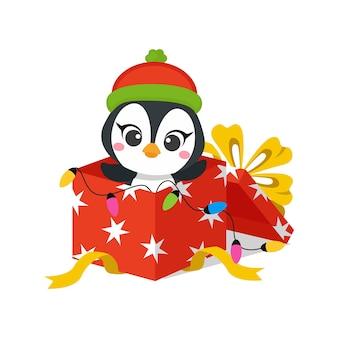 Słodki pingwin świętuje boże narodzenie w prezentowym pudełku