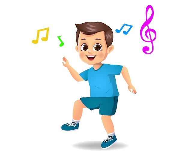 Słodkie dziecko chłopiec tańczy do muzyki na białym tle