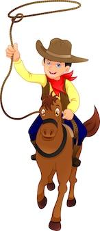 Słodkie dziecko kowboj z koniem