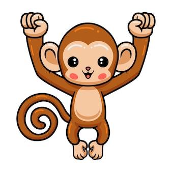 Słodkie dziecko małpa kreskówka pozowanie