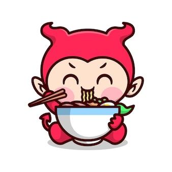 Słodkie dziecko w czerwonym kostiumu diabeł je dużą miskę klubu z pałeczkami wysokiej jakości kreskowany projekt maskotki