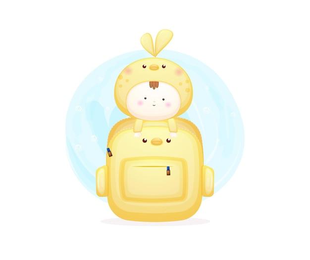 Słodkie dziecko w kostiumie ptaka wewnątrz torby premium wektor