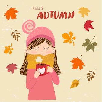 Słodkie dziewczyny w ciepły sweter z szalikiem trzymając kubek kawy z tekstem witam jesień.