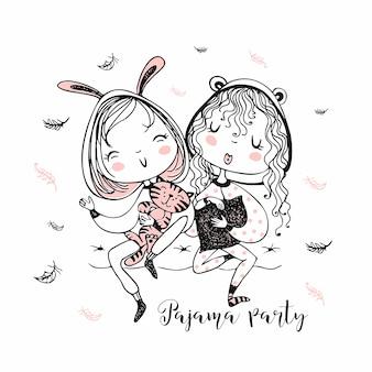 Słodkie dziewczyny w piżamie bawią się na imprezie z piżamą.