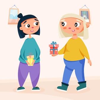 Słodkie dziewczyny wymieniają się prezentami w pokoju