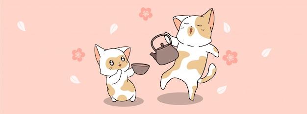 Słodkie koty piją herbatę